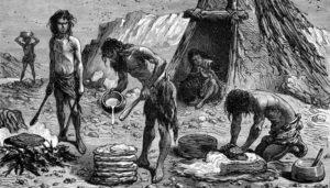 Первобытные люди готовят пищу